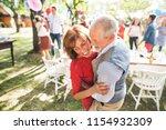 a senior couple dancing on a... | Shutterstock . vector #1154932309
