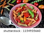 multicolored penne pasta with... | Shutterstock . vector #1154935660