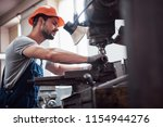 experienced operator in a hard... | Shutterstock . vector #1154944276