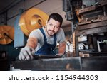 experienced operator in a hard... | Shutterstock . vector #1154944303