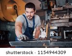 experienced operator in a hard... | Shutterstock . vector #1154944309