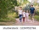 family walking in park on... | Shutterstock . vector #1154952766