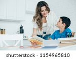 portrait of smiling mother... | Shutterstock . vector #1154965810