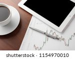 finance table on a wooden table ... | Shutterstock . vector #1154970010