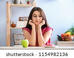 woman with tasty doughnut and... | Shutterstock . vector #1154982136