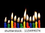 burning candles on black... | Shutterstock . vector #115499074