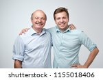 hispanic father and adult son... | Shutterstock . vector #1155018406