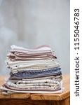 a stack of linen textiles on a... | Shutterstock . vector #1155046783