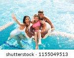 joyful young family having fun... | Shutterstock . vector #1155049513