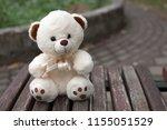 teddy bear is sitting alone on... | Shutterstock . vector #1155051529