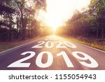 empty asphalt road and new year ... | Shutterstock . vector #1155054943