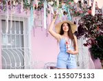 fashionable lady with long hair ... | Shutterstock . vector #1155075133