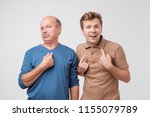 two shocked  surprised  mature... | Shutterstock . vector #1155079789
