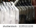 black and white shirts on... | Shutterstock . vector #1155111133