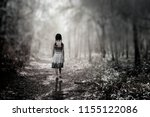 Small photo of The black and white girl walked astray in the morning with beautiful sunlight.