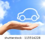 hand with car against blue sky... | Shutterstock . vector #115516228