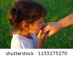 the little girl kisses the old... | Shutterstock . vector #1155175270