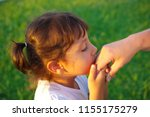 the little girl kisses the old... | Shutterstock . vector #1155175279