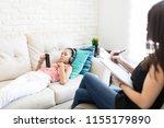 girl listening to music on...   Shutterstock . vector #1155179890