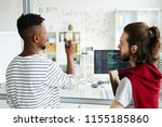young it specialists standing...   Shutterstock . vector #1155185860