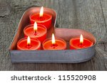 Red Candles On A Heart Shaped...