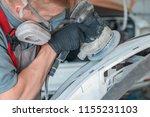 auto mechanic grinds car part... | Shutterstock . vector #1155231103