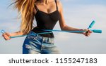 athletic slim woman measuring... | Shutterstock . vector #1155247183