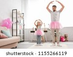 father and daughter in pink... | Shutterstock . vector #1155266119