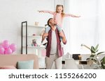 daughter sitting on fathers... | Shutterstock . vector #1155266200