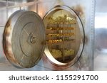 an open safe with gold and... | Shutterstock . vector #1155291700