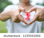 woman hands holding red aids... | Shutterstock . vector #1155331003