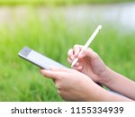 close up woman using tablet... | Shutterstock . vector #1155334939