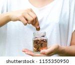 woman saving money | Shutterstock . vector #1155350950