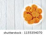 crispy potato waffles fries ... | Shutterstock . vector #1155354070
