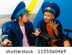 happy kids playing airplane.... | Shutterstock . vector #1155360469