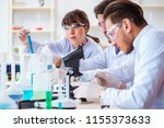 team of chemists working in the ... | Shutterstock . vector #1155373633