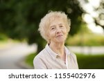 outdoor portrait of beautiful... | Shutterstock . vector #1155402976