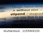 Small photo of stipend word in a dictionary. stipend concept.