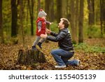 little boy with his father... | Shutterstock . vector #1155405139