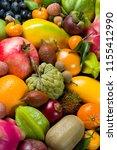 exotic tropical fruits heap ... | Shutterstock . vector #1155412990
