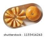 tangerine on plate.  preparing...   Shutterstock . vector #1155416263