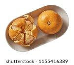 tangerine on plate.  preparing...   Shutterstock . vector #1155416389