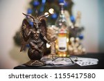 the statue demon and a bottle... | Shutterstock . vector #1155417580