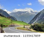 Driving in Swiss Alps. Beautiful road in Switzerland.  - stock photo