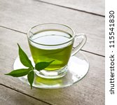 Stock photo a cup of green tea on wood board drink for health 115541830