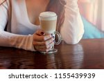 latte macchiato drink in tall... | Shutterstock . vector #1155439939