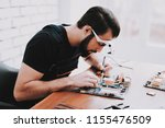 young bearded man repairing... | Shutterstock . vector #1155476509