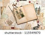 Small photo of old postcards and open empty book. vintage travel background