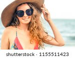 happy young woman wearing... | Shutterstock . vector #1155511423