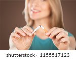 young woman breaking cigarette  ... | Shutterstock . vector #1155517123